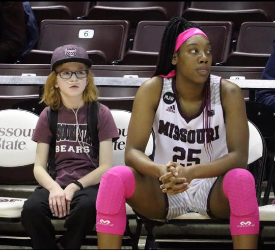 Elise Drennan sits on the bench with Lady Bears freshman Dariauna Lewis during a  game.