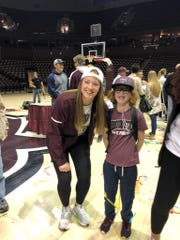 Elise Drennan smiles for a photo with Lady Bears sophomore Abby Hipp at MSU's NCAA Tournament celebration.