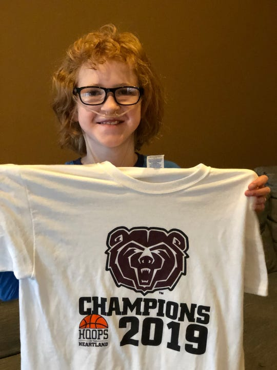 Elise Drennan with her MVC champions T-shirt.