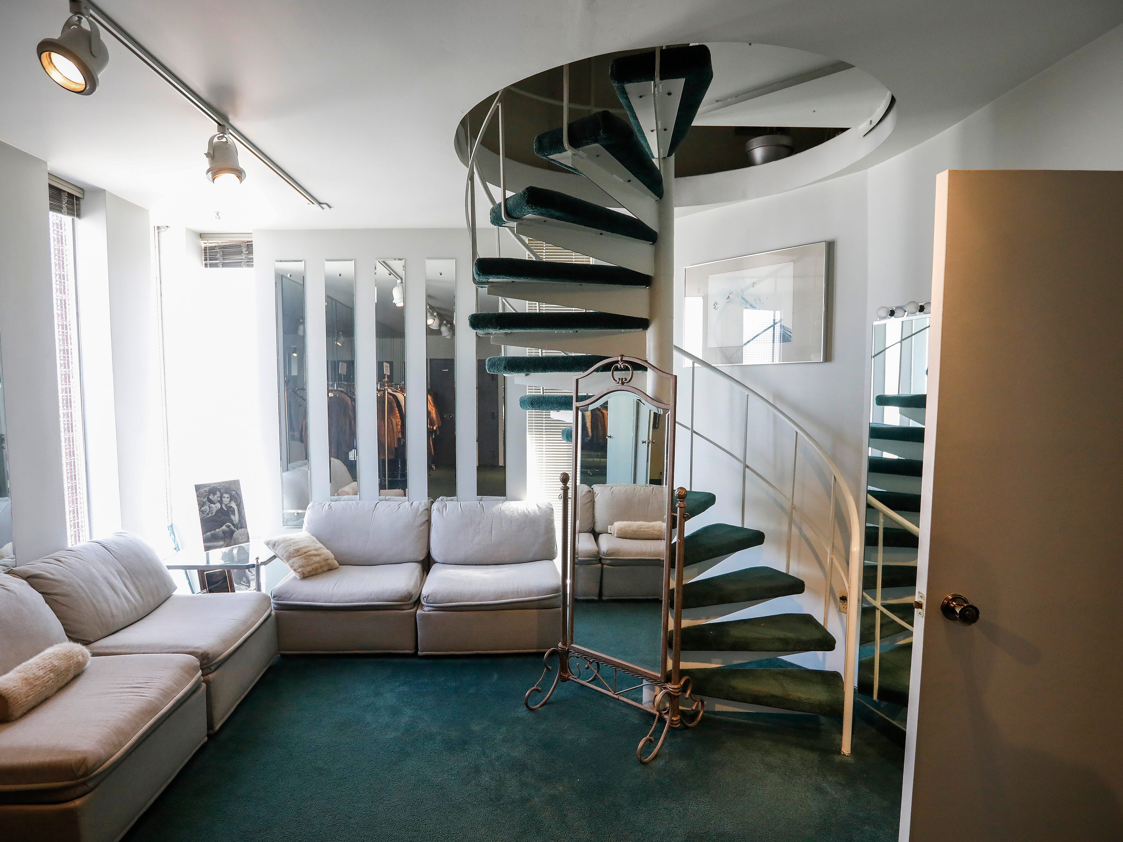 A spiral staircase leads up to the second floor at McDaniel Furs, located at 901 S. Glenstone Ave.