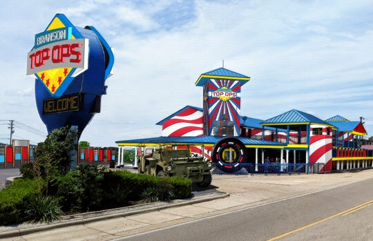 As shown in this preliminary digital rendering, Branson Top Ops will be a patriotic-themed attraction offering an interactive outdoor maze, indoor laser tag, and other adventures.
