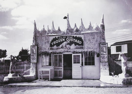 A photograph at McDaniel Furs of a frozen custard shop with two bears throwing snowballs on the sides.