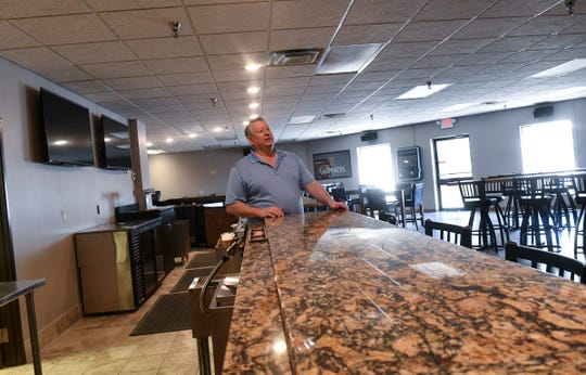 Owner Craig Weaver talks about features of the new Midtown Bar & Grill Thursday, March 21, in St. Cloud.