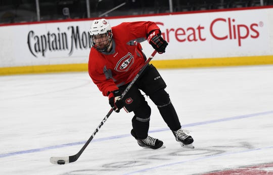 St. Cloud State senior forward Jacob Benson gets ready to pass the puck in practice Thursday, March 21, at the Xcel Energy Center in St. Paul.