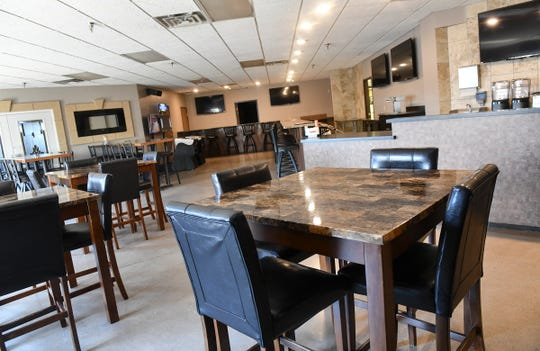 Tables are in place at the site of the future Midtown Bar & Grill Thursday, March 21, in St. Cloud.