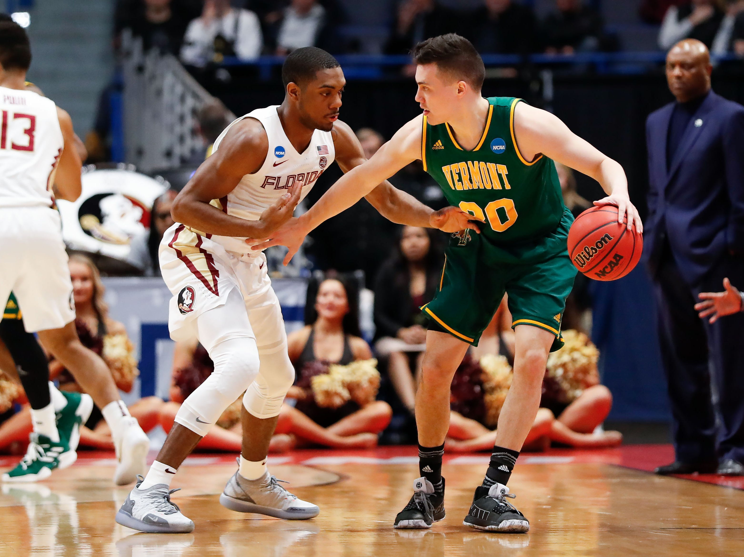 Mar 21, 2019; Hartford, CT, USA; Vermont Catamounts guard Ernie Duncan (20) controls the ball in front of Florida State Seminoles guard Trent Forrest (3) during the first half of a game in the first round of the 2019 NCAA Tournament at XL Center. Mandatory Credit: David Butler II-USA TODAY Sports