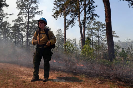Lacey England, a woman who works with the National Forest Service and is based in Montana, talks about the importance of prescribed burns Thursday, March 21, 2019.  Tall Timbers in Tallahassee, Fla. hosts Women-in-Fire Prescribed Fire Training Exchange (WTREX) which engages women and men  working to advance their leadership in wildland fire management.