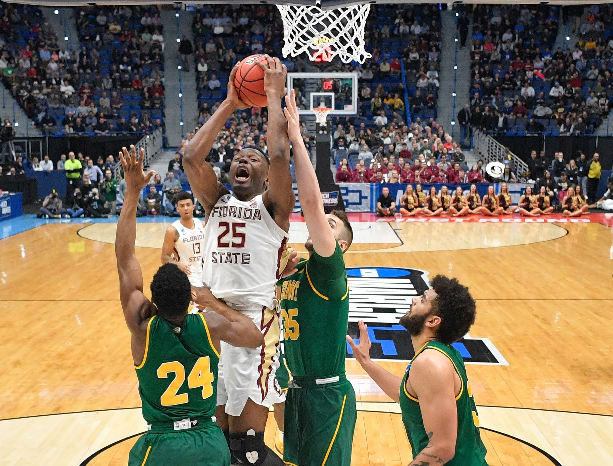 Mar 21, 2019; Hartford, CT, USA; Florida State Seminoles forward Mfiondu Kabengele (25) attempts a layup against the Vermont Catamounts during the first half of a game in the first round of the 2019 NCAA Tournament at XL Center. Mandatory Credit: David Butler II-USA TODAY Sports
