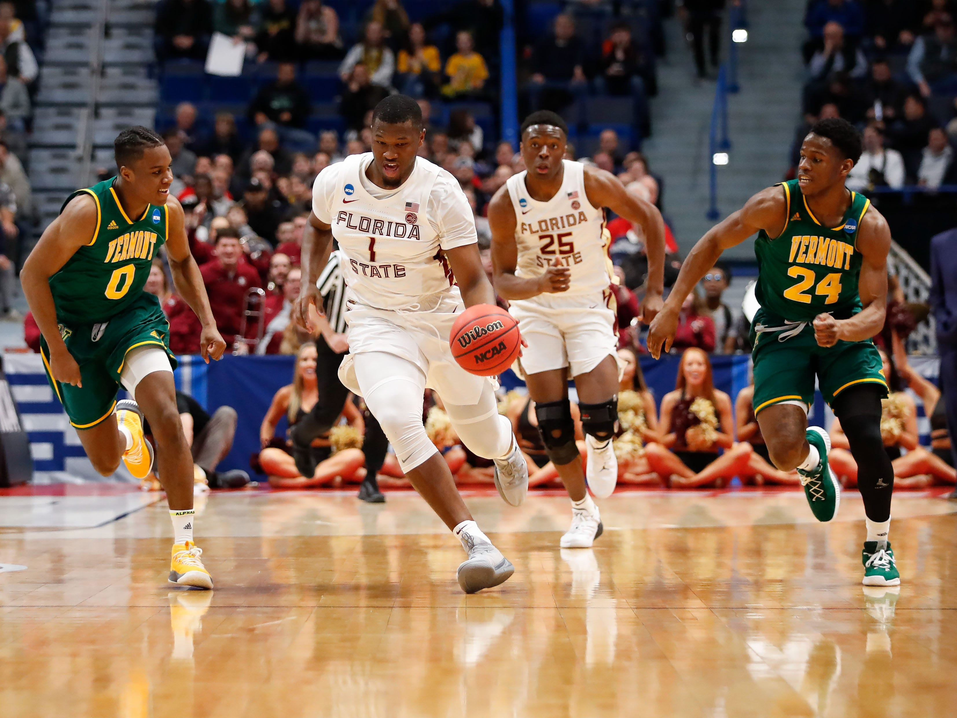 Mar 21, 2019; Hartford, CT, USA; Florida State Seminoles forward Raiquan Gray (1) dribbles the ball up the court during the first half of a game against the Vermont Catamounts in the first round of the 2019 NCAA Tournament at XL Center. Mandatory Credit: David Butler II-USA TODAY Sports