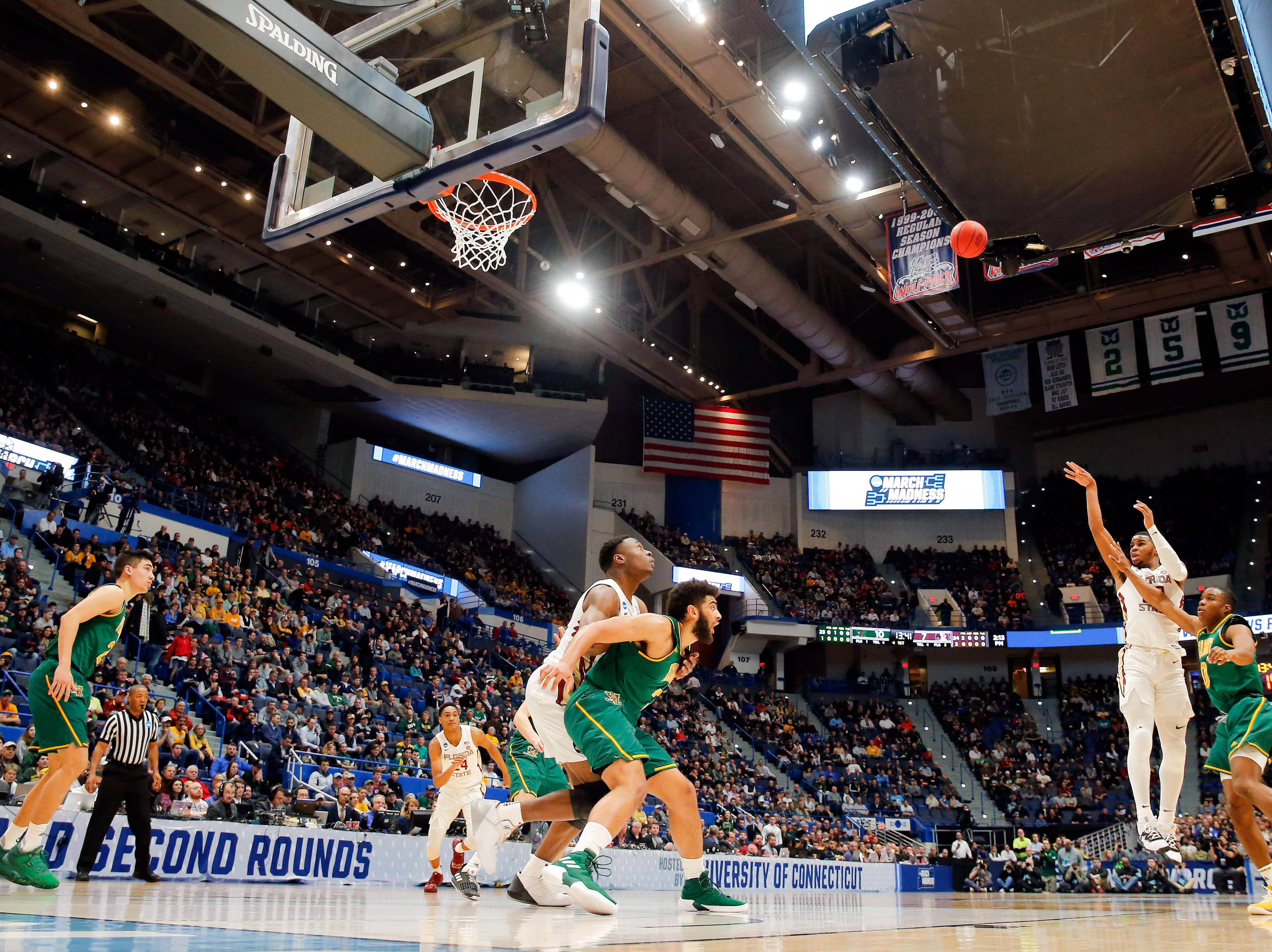 Mar 21, 2019; Hartford, CT, USA; Florida State Seminoles guard M.J. Walker (23) attempts a three point basket against the Vermont Catamounts during the first half of a game in the first round of the 2019 NCAA Tournament at XL Center. Mandatory Credit: David Butler II-USA TODAY Sports