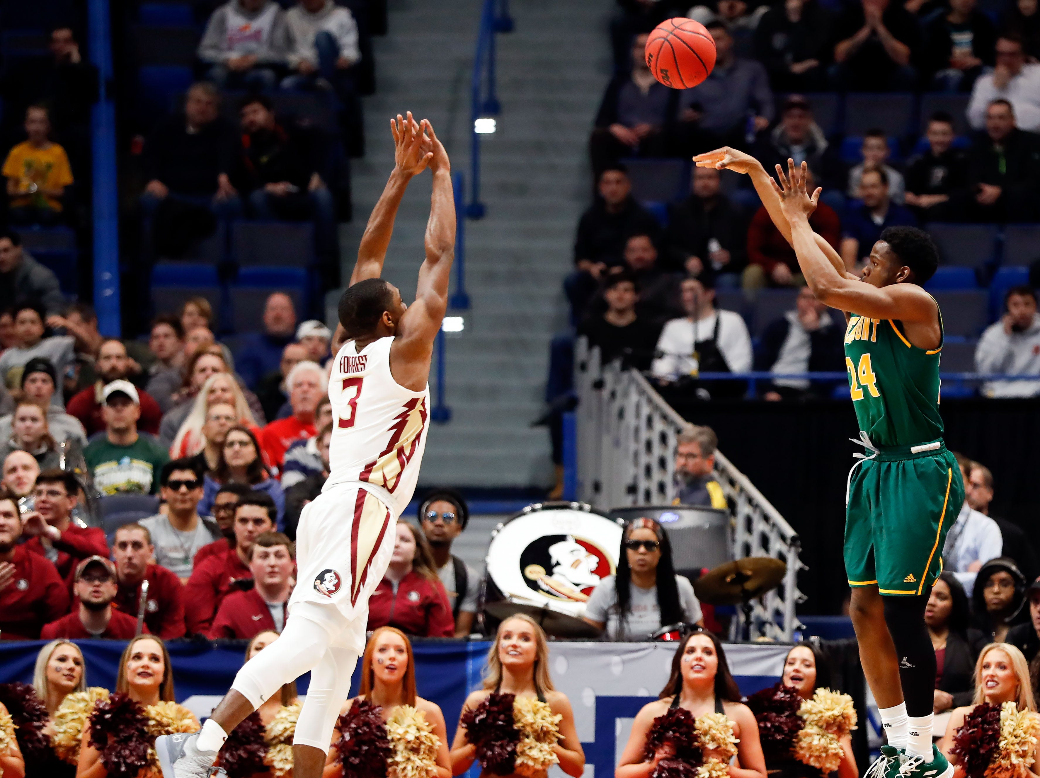 Mar 21, 2019; Hartford, CT, USA; Vermont Catamounts guard Ben Shungu (24) attempts a three point basket over Florida State Seminoles guard Trent Forrest (3) during the first half of a game in the first round of the 2019 NCAA Tournament at XL Center. Mandatory Credit: David Butler II-USA TODAY Sports