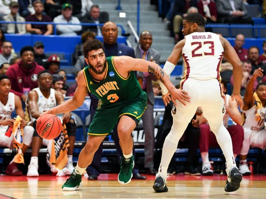 Mar 21, 2019; Hartford, CT, USA; Vermont Catamounts forward Anthony Lamb (3) controls the ball in front of Florida State Seminoles guard M.J. Walker (23) during the first half of a game in the first round of the 2019 NCAA Tournament at XL Center. Mandatory Credit: Robert Deutsch-USA TODAY Sports
