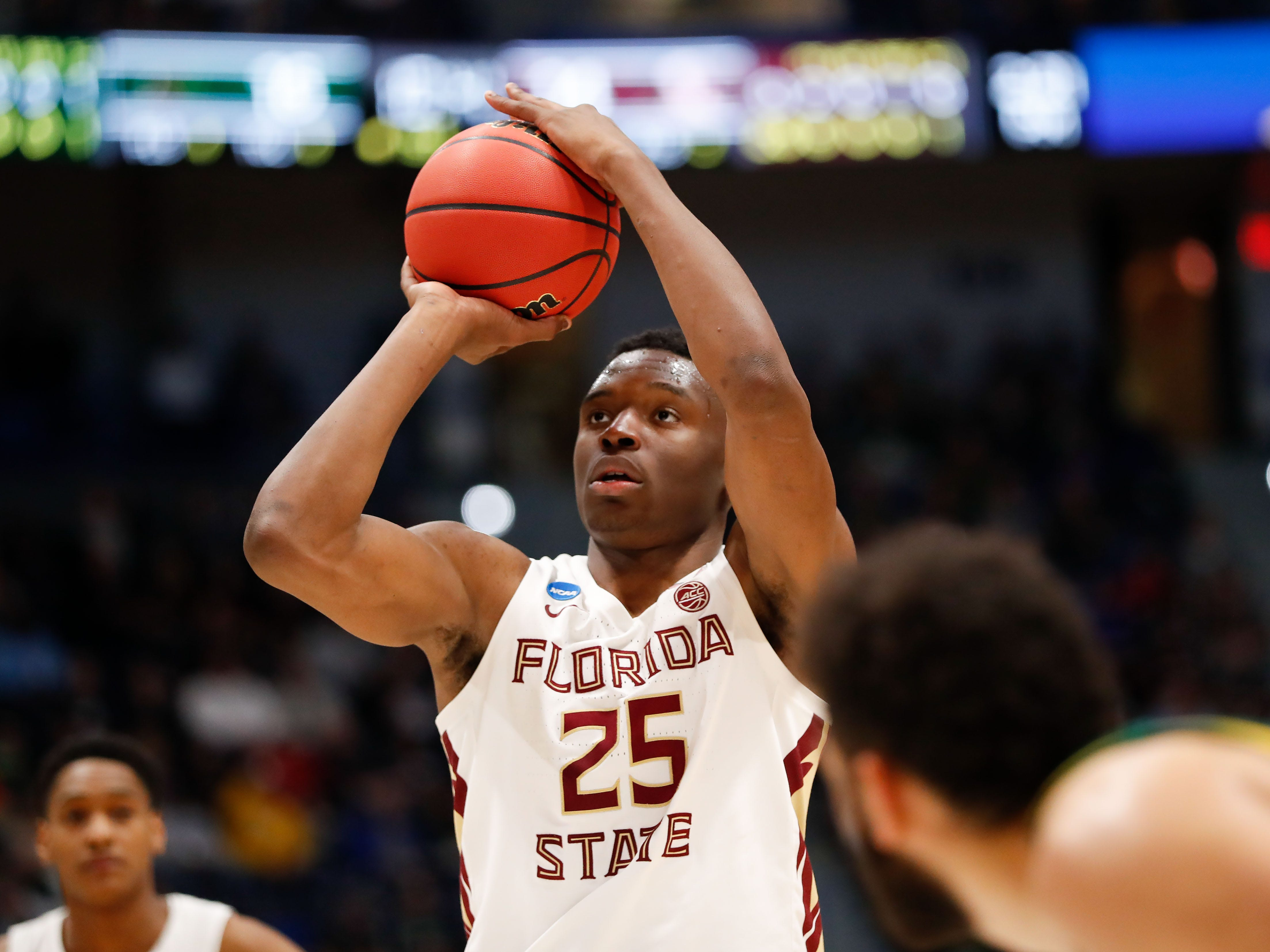 Mar 21, 2019; Hartford, CT, USA; Florida State Seminoles forward Mfiondu Kabengele (25) attempts a free throw against the Vermont Catamounts during the first half of game in the first round of the 2019 NCAA Tournament at XL Center. Mandatory Credit: David Butler II-USA TODAY Sports