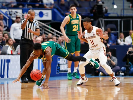 Mar 21, 2019; Hartford, CT, USA; Vermont Catamounts guard Ben Shungu (24) dives for a loose ball in front of Florida State Seminoles guard David Nichols (11) during the first half of game in the first round of the 2019 NCAA Tournament at XL Center. Mandatory Credit: David Butler II-USA TODAY Sports