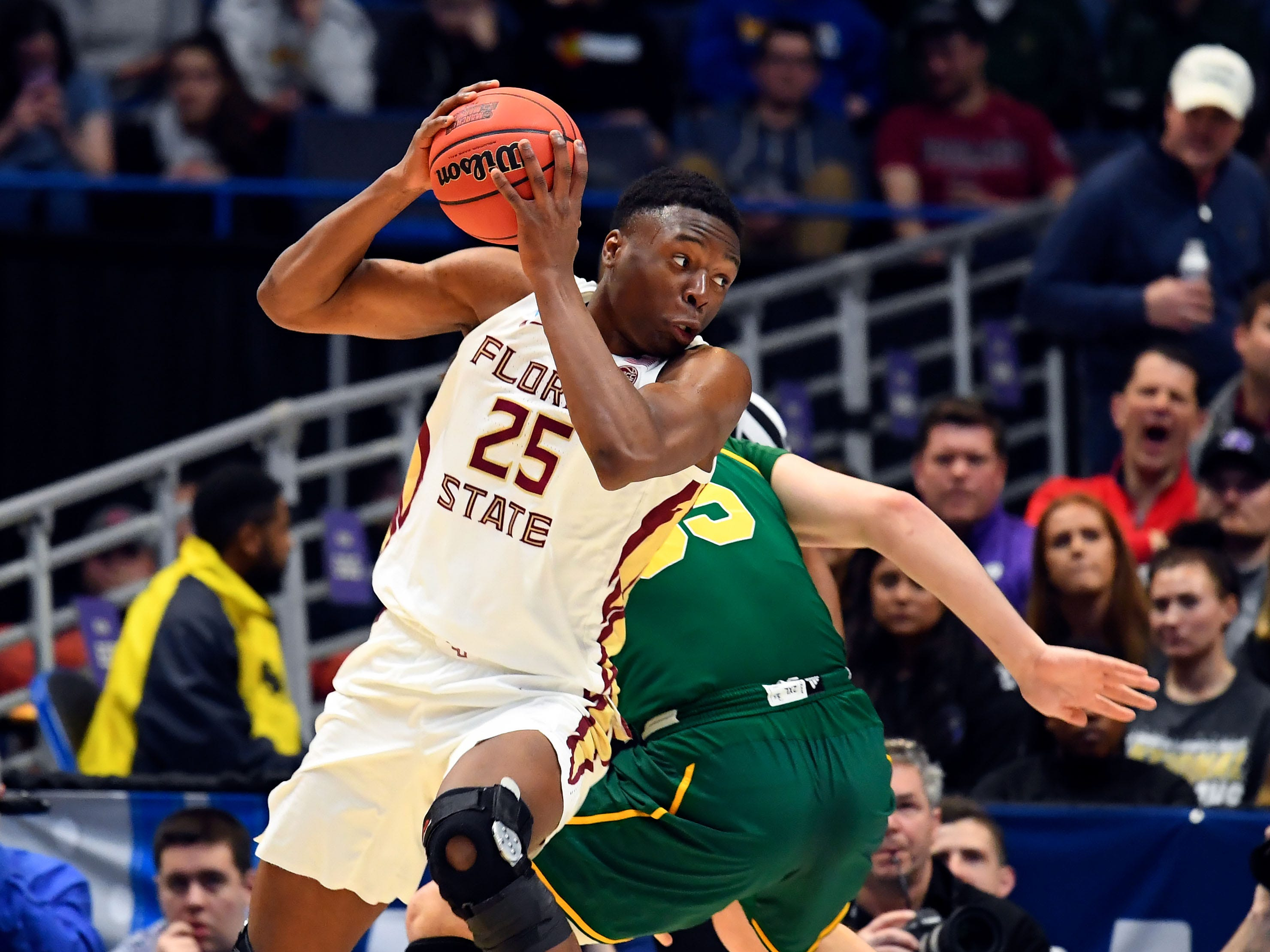 Mar 21, 2019; Hartford, CT, USA; Florida State Seminoles forward Mfiondu Kabengele (25) drives to the basket against the Vermont Catamounts during the first half of a game in the first round of the 2019 NCAA Tournament at XL Center. Mandatory Credit: Robert Deutsch-USA TODAY Sports