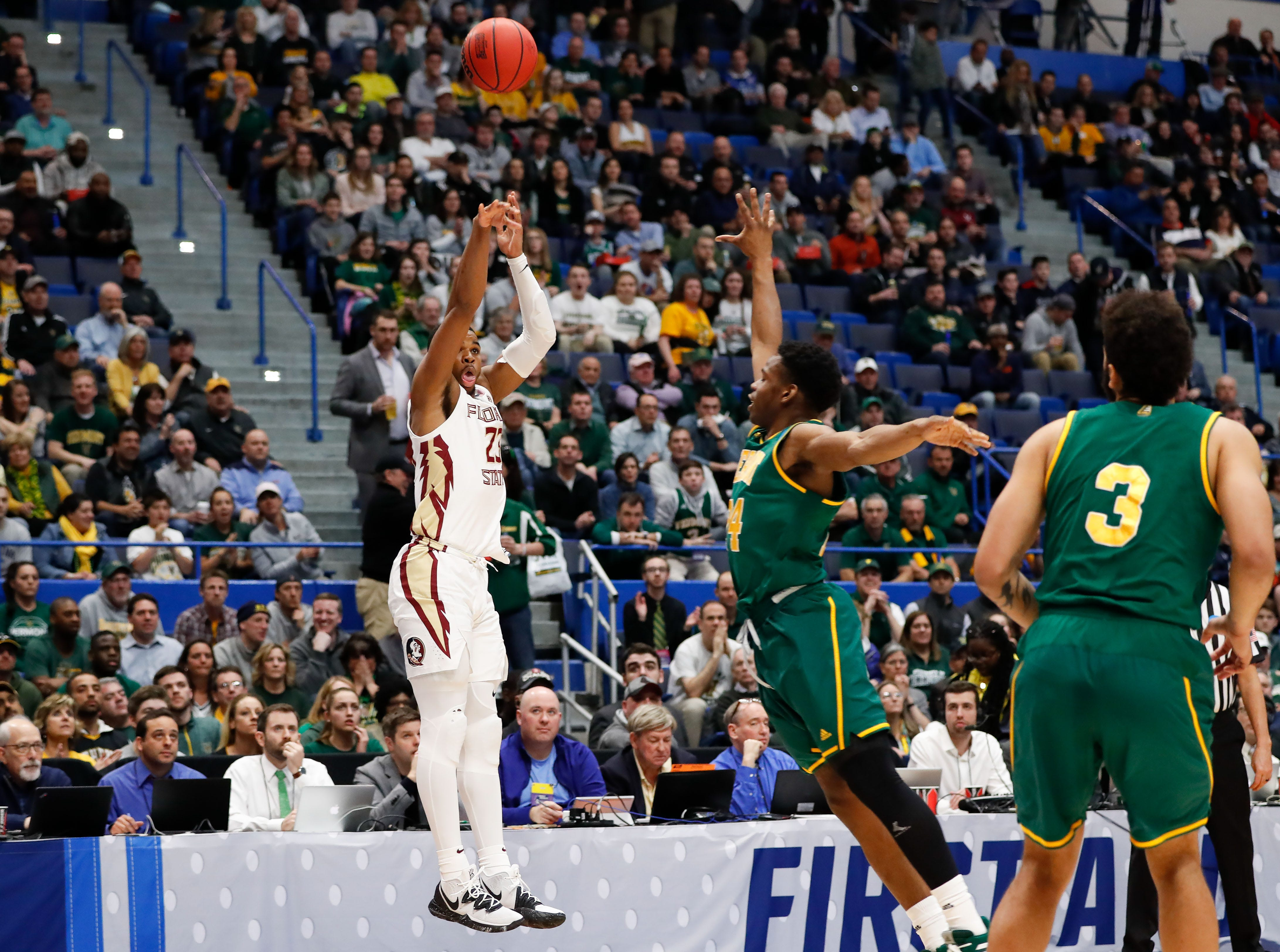 Mar 21, 2019; Hartford, CT, USA; Florida State Seminoles guard M.J. Walker (23) attempts a three point basket against the Vermont Catamounts during the first half in the first round of the 2019 NCAA Tournament at XL Center. Mandatory Credit: David Butler II-USA TODAY Sports