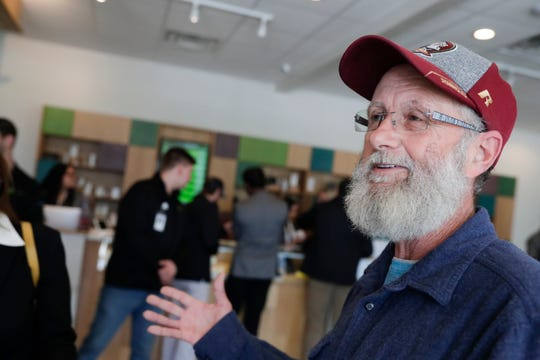 Douglas Dixon talks to the press after becoming the first person in Florida to purchase smokable medical marijuana at Trulieve on Capital Circle near Park Avenue in Tallahassee Thursday, March 21, 2019.