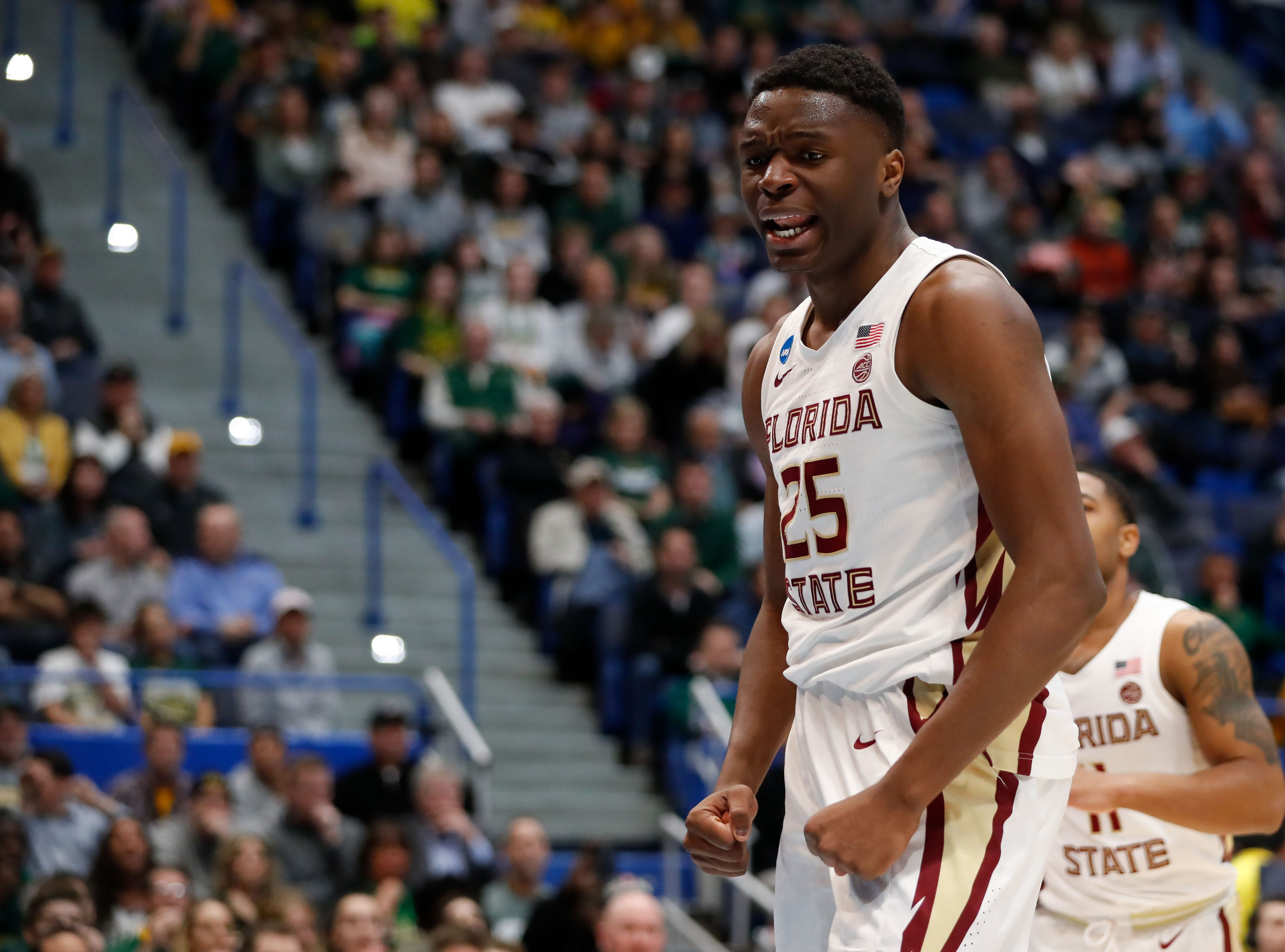 Mar 21, 2019; Hartford, CT, USA; Florida State Seminoles forward Mfiondu Kabengele (25) reacts after a score against the Vermont Catamounts during the first half of game in the first round of the 2019 NCAA Tournament at XL Center. Mandatory Credit: David Butler II-USA TODAY Sports