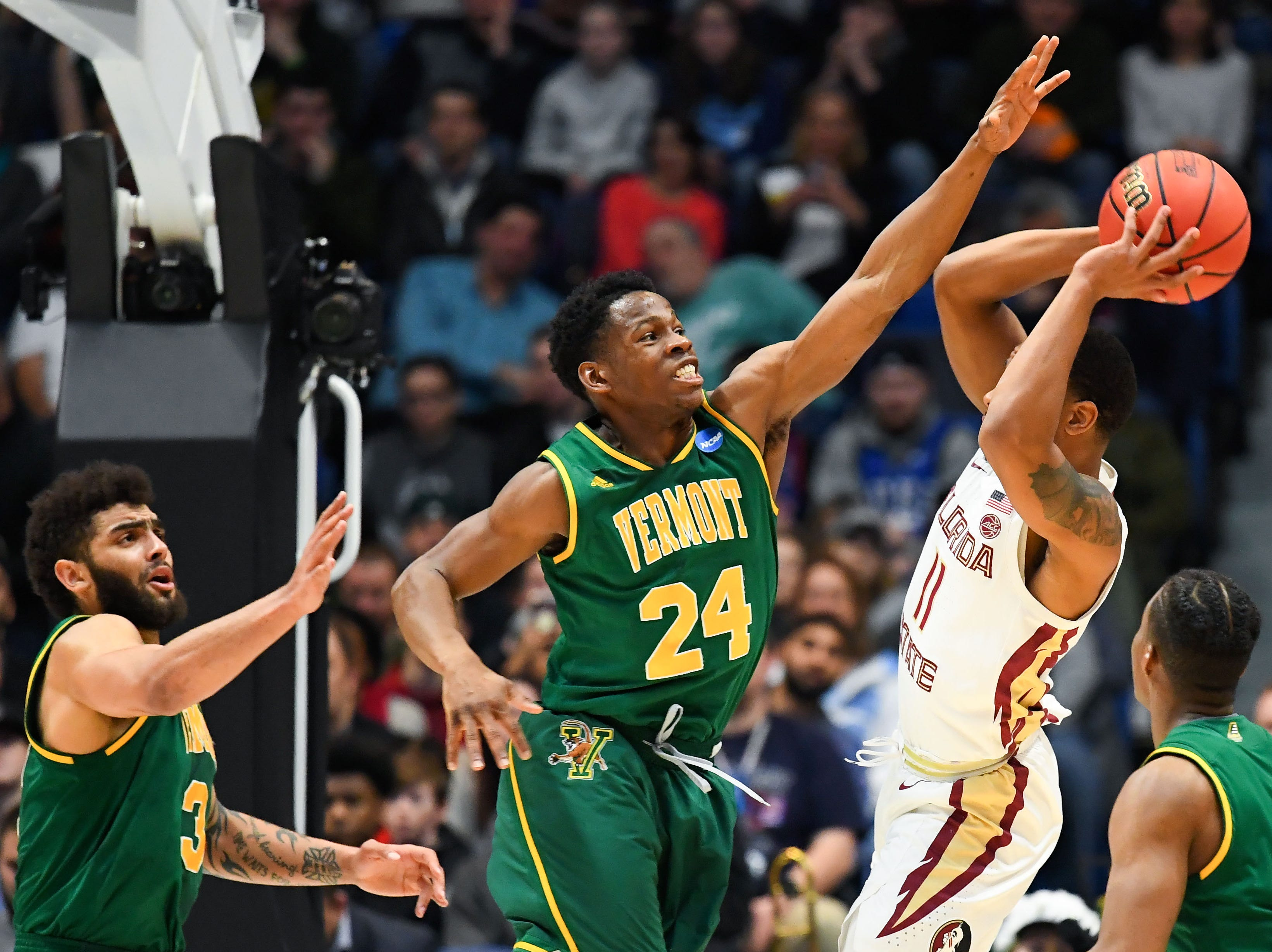 Mar 21, 2019; Hartford, CT, USA; Vermont Catamounts guard Ben Shungu (24) defends against Florida State Seminoles guard David Nichols (11) during the first half of a game in the first round of the 2019 NCAA Tournament at XL Center. Mandatory Credit: Robert Deutsch-USA TODAY Sports