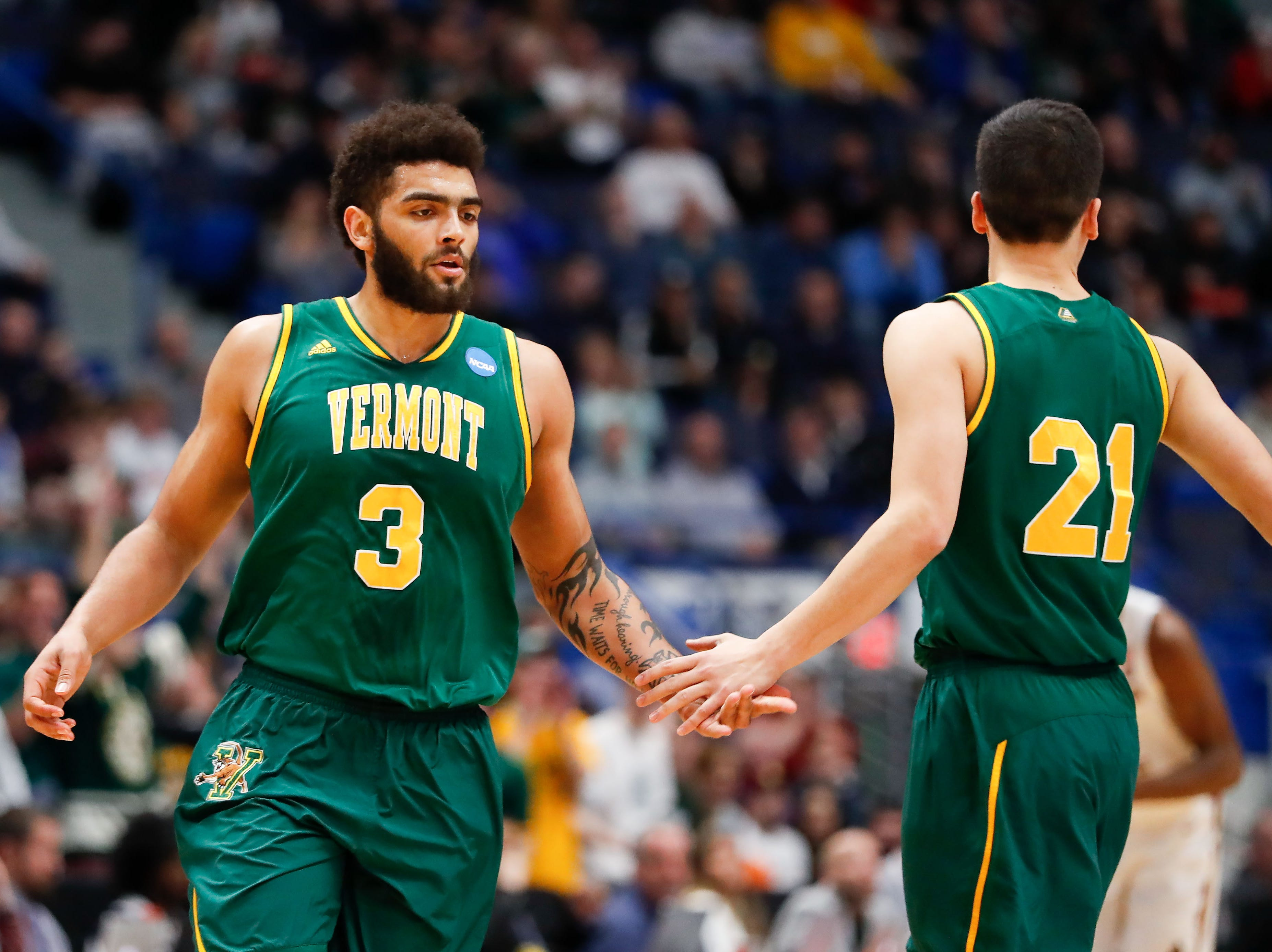Mar 21, 2019; Hartford, CT, USA; Vermont Catamounts forward Anthony Lamb (3) and guard Everett Duncan (21) high give after a score against the Florida State Seminoles during the first half of a game in the first round of the 2019 NCAA Tournament at XL Center. Mandatory Credit: David Butler II-USA TODAY Sports