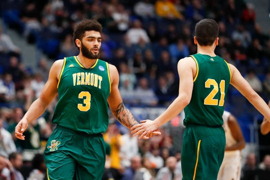 Anthony Lamb, left, gives a high-five to teammate Everett Duncan during the NCAA Tournament first-round game vs Florida State in Hartford, Connecticut, on March 21.