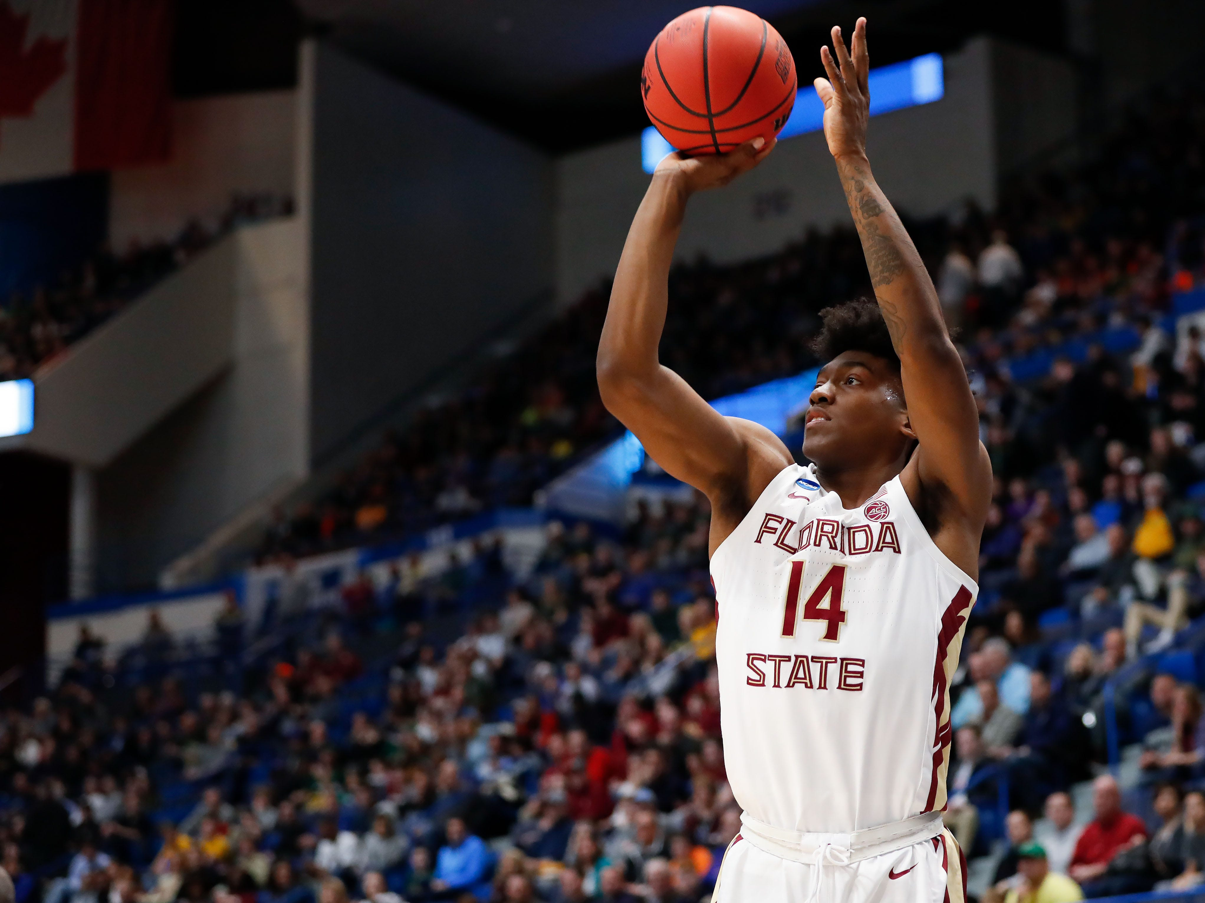 Mar 21, 2019; Hartford, CT, USA; Florida State Seminoles guard Terance Mann (14) attempts a three point basket against against the Vermont Catamounts during the first half of a game in the first round of the 2019 NCAA Tournament at XL Center. Mandatory Credit: David Butler II-USA TODAY Sports