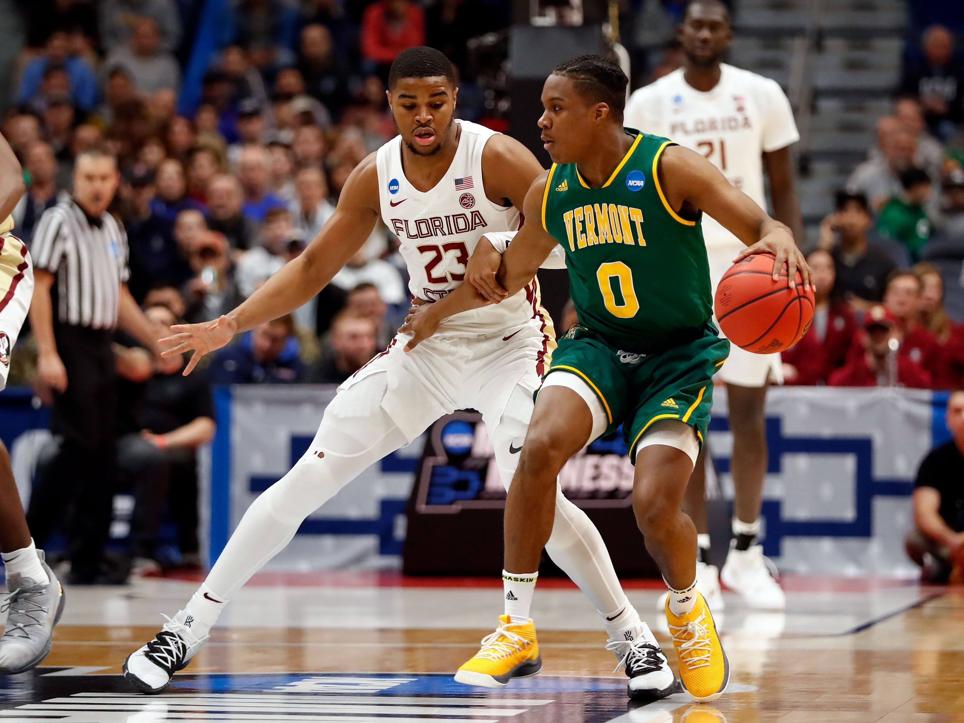 Mar 21, 2019; Hartford, CT, USA; Vermont Catamounts guard Stef Smith (0) controls the ball in front of Florida State Seminoles guard M.J. Walker (23) during the first half of a game in the first round of the 2019 NCAA Tournament at XL Center. Mandatory Credit: David Butler II-USA TODAY Sports
