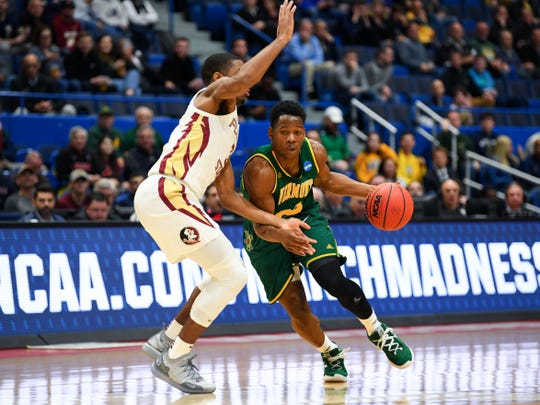 Mar 21, 2019; Hartford, CT, USA; Vermont Catamounts guard Ben Shungu (24) drives against Florida State Seminoles guard Trent Forrest (3) during the first half of a game in the first round of the 2019 NCAA Tournament at XL Center. Mandatory Credit: Robert Deutsch-USA TODAY Sports