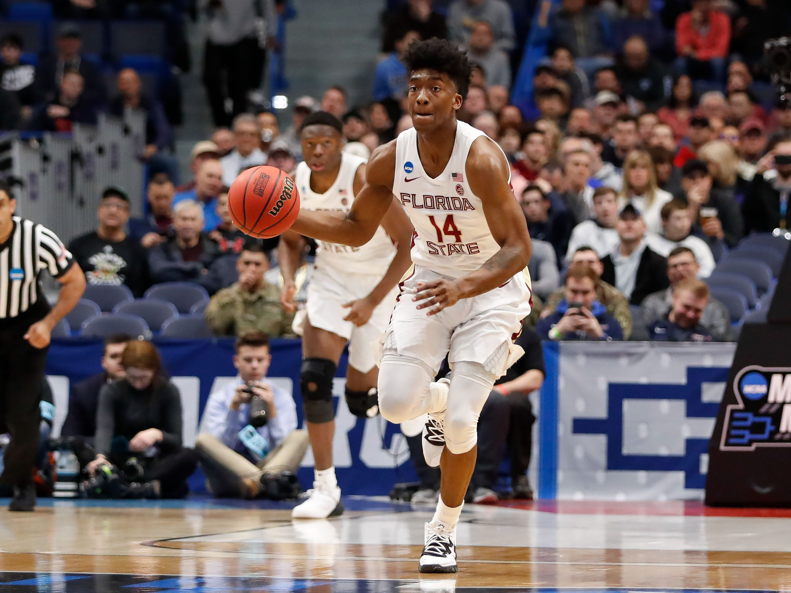 Mar 21, 2019; Hartford, CT, USA; Florida State Seminoles guard Terance Mann (14) dribbles the ball up the court during the first half of a game against the Vermont Catamounts in the first round of the 2019 NCAA Tournament at XL Center. Mandatory Credit: David Butler II-USA TODAY Sports