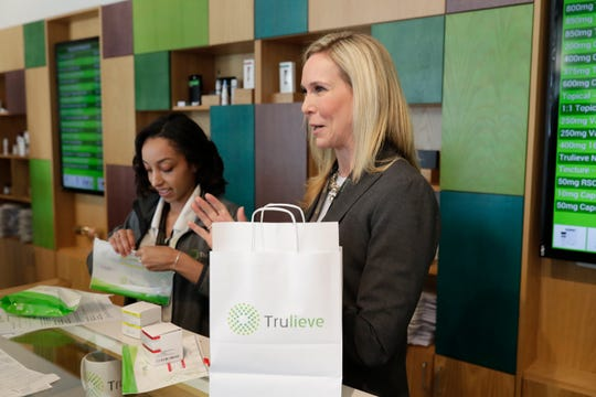 Trulieve CEO Kim Rivers explains the regulations for packaging of smokable medical marijuana as the first products are sold to Douglas Dixon at Trulieve on Capital Circle near Park Avenue in Tallahassee Thursday, March 21, 2019.