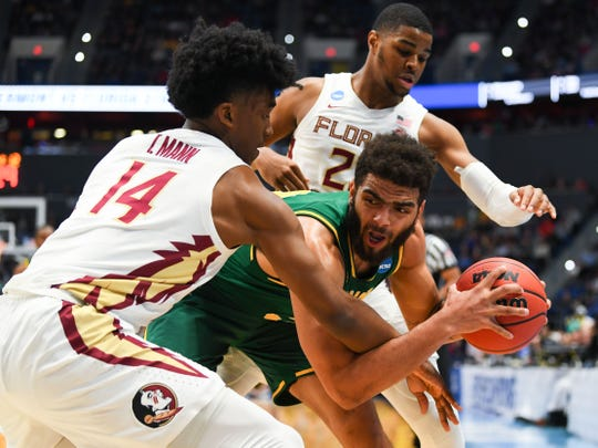 Mar 21, 2019; Hartford, CT, USA; Vermont Catamounts forward Anthony Lamb (3) looks to pass around Florida State Seminoles guard Terance Mann (14) during the first half of a game in the first round of the 2019 NCAA Tournament at XL Center. Mandatory Credit: Robert Deutsch-USA TODAY Sports