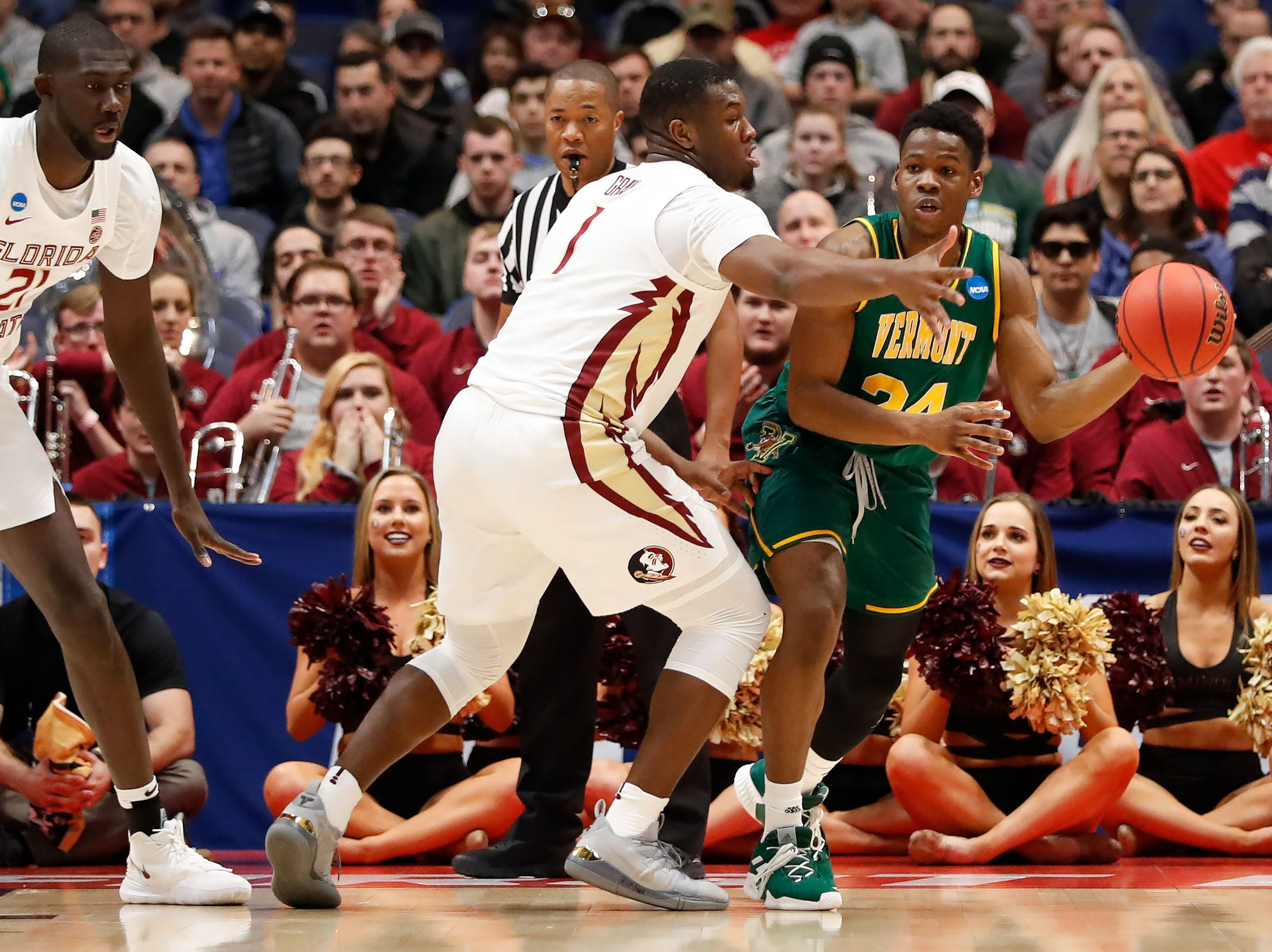 Mar 21, 2019; Hartford, CT, USA; Vermont Catamounts guard Ben Shungu (24) looks to pass around Florida State Seminoles forward Raiquan Gray (1) during the first half of game in the first round of the 2019 NCAA Tournament at XL Center. Mandatory Credit: David Butler II-USA TODAY Sports