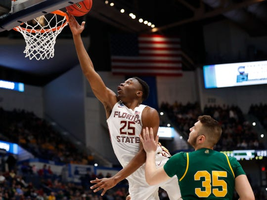 Mar 21, 2019; Hartford, CT, USA; Florida State Seminoles forward Mfiondu Kabengele (25) attempts a layup in front of Vermont Catamounts forward Ryan Davis (35) during the first half of game in the first round of the 2019 NCAA Tournament at XL Center. Mandatory Credit: David Butler II-USA TODAY Sports