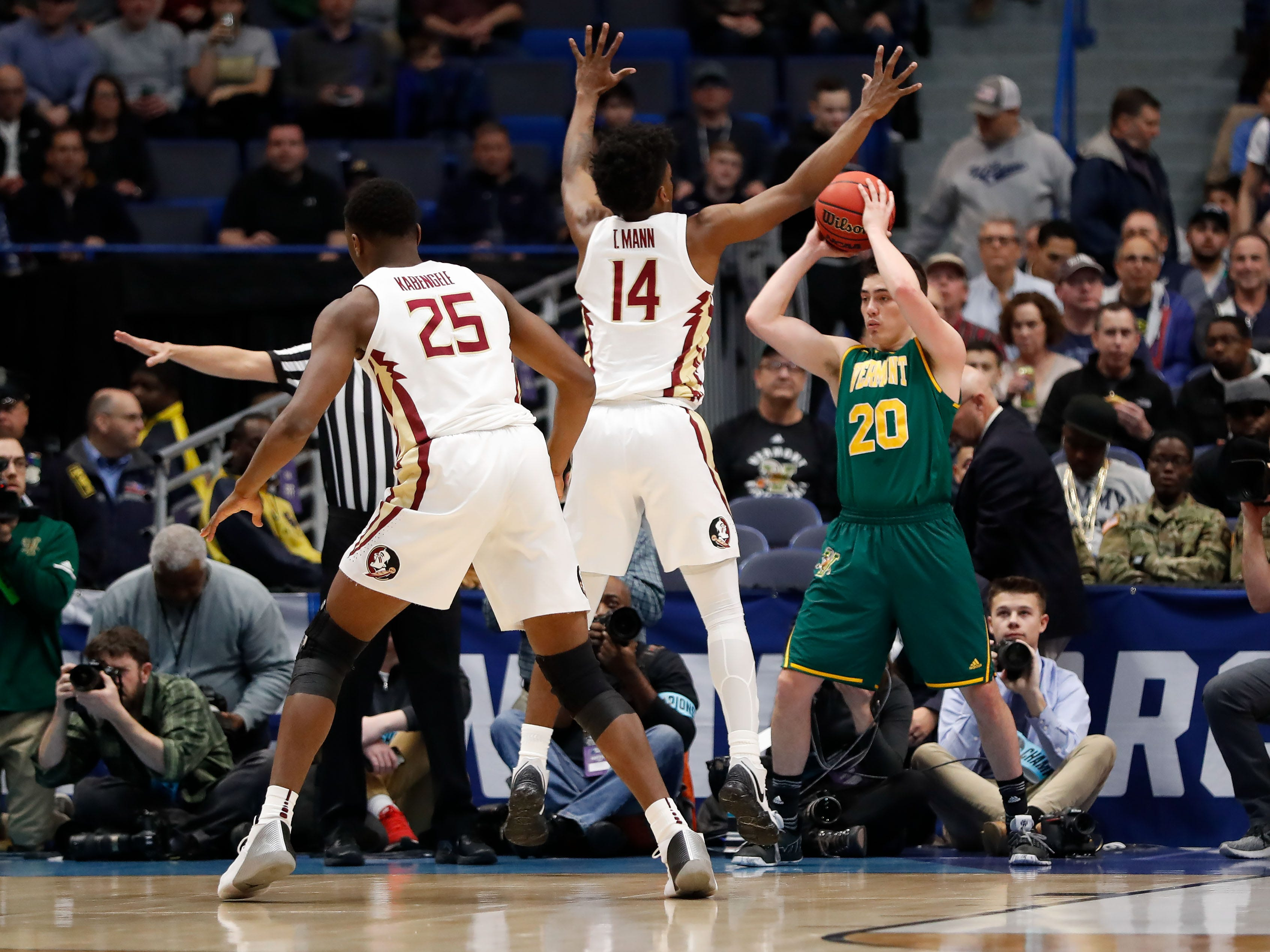 Mar 21, 2019; Hartford, CT, USA; Vermont Catamounts guard Ernie Duncan (20) looks to pass the ball around Florida State Seminoles guard Terance Mann (14) during the first half of a game in the first round of the 2019 NCAA Tournament at XL Center. Mandatory Credit: David Butler II-USA TODAY Sports