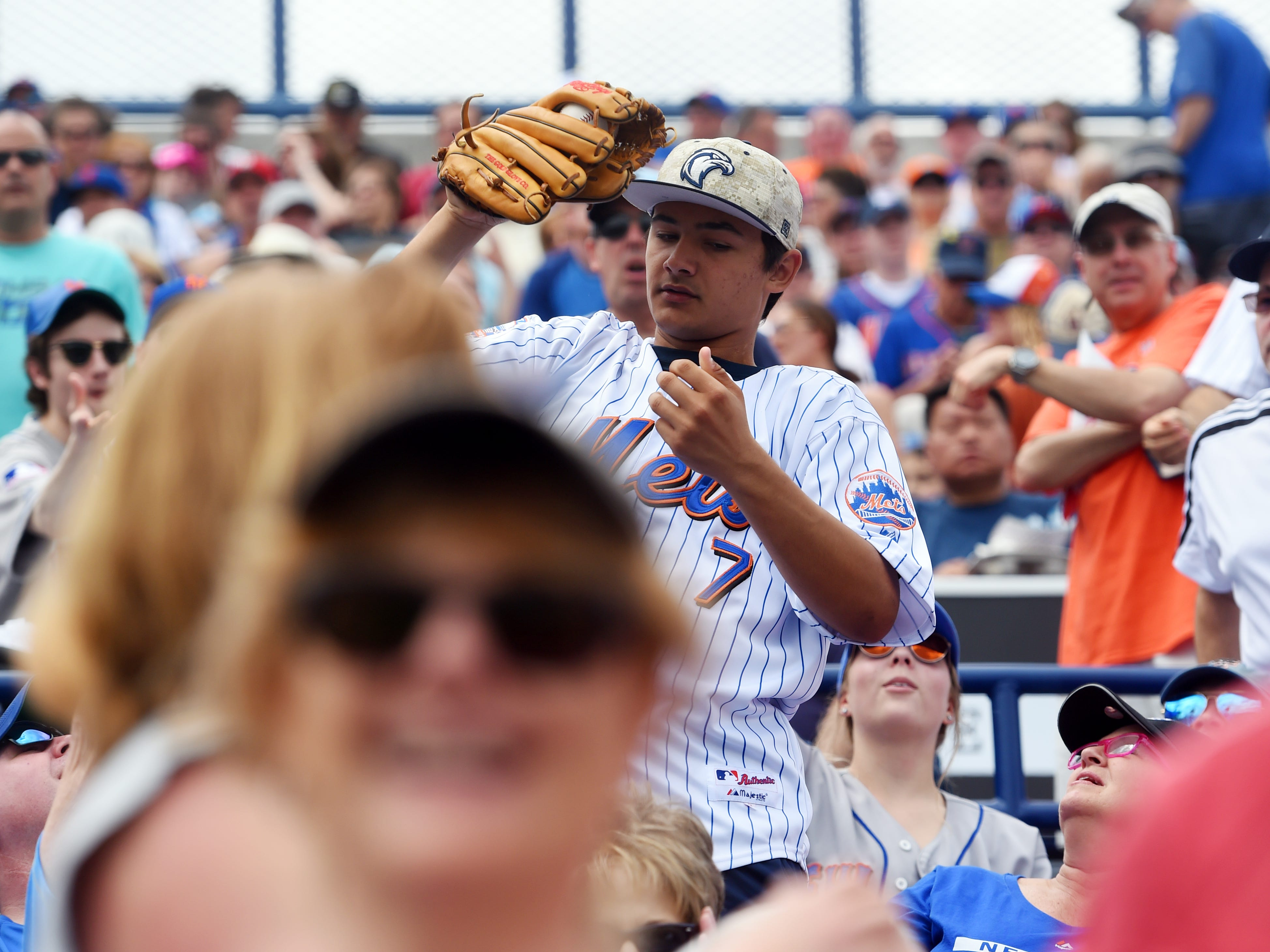 Daniel Garvin, 16, of Winter Park, hauls in a baseball thrown into the stands by New York Mets outfielder Jeff McNeil before the Mets' spring training game against the Miami Marlins on Thursday, March 21, 2019 at First Data Field in Port St. Lucie. Fans only have two more chances to watch the Mets at First Data Field during spring training, Friday at 1:10 p.m. and Sunday at 12:10 p.m.