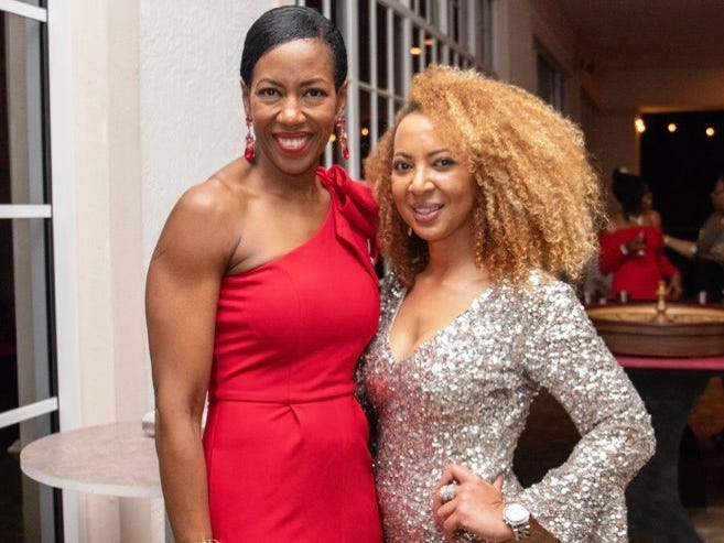 "Jean Laws-Scott and Event Co-Chair Natasha Harrison at the ""Lucky In Love"" Valentine's Day gala."
