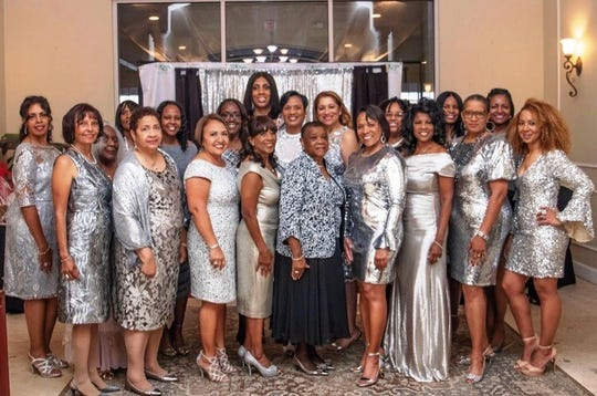 "Members of Treasure Coast Chapter of The Links, Inc. at the ""Lucky In Love"" Valentine's Day gala at Santa Lucia River Club at Ballantrae in Port St. Lucie."