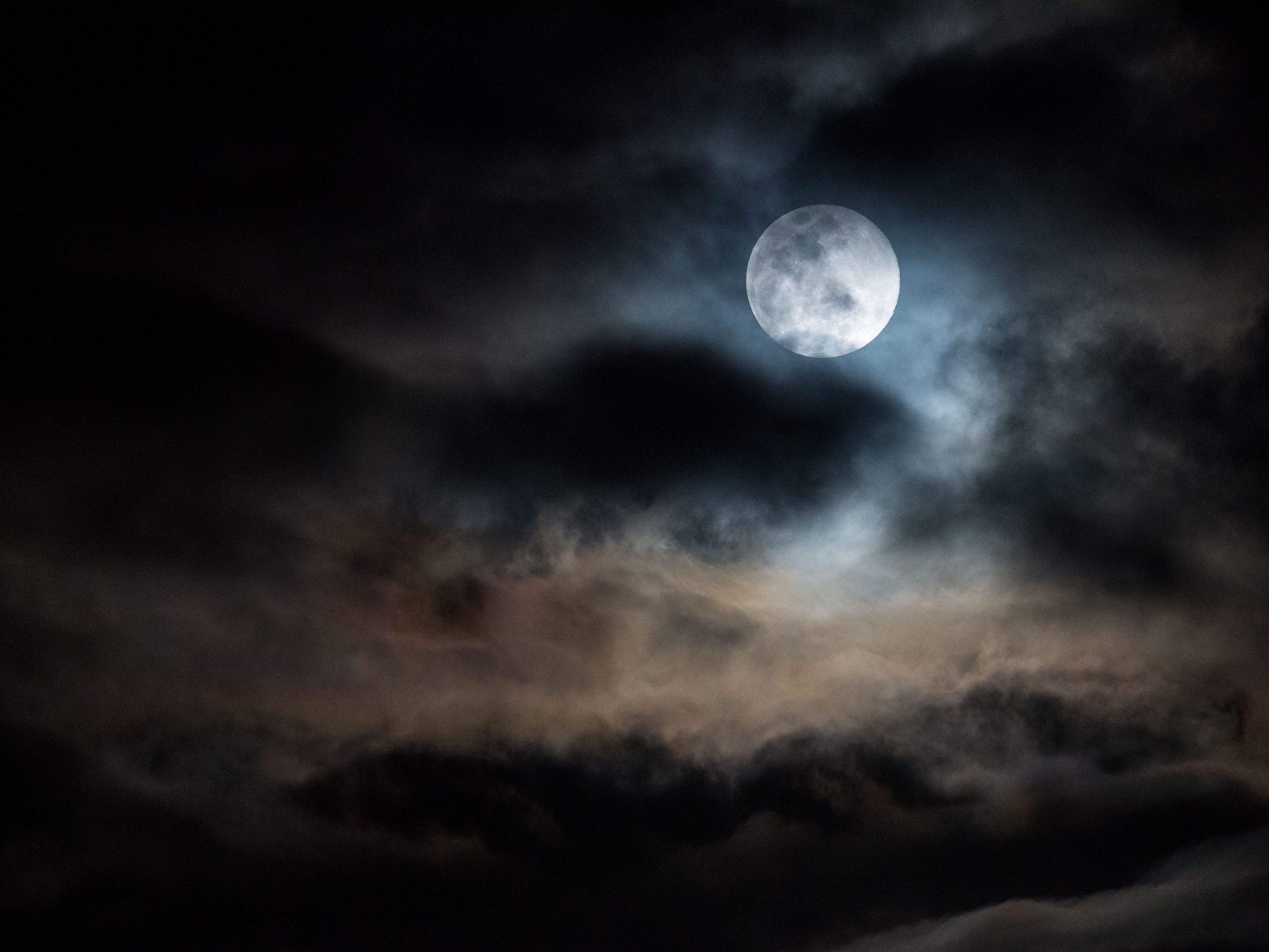 """The last supermoon of 2019, the """"super worm equinox moon,"""" makes an appearance though an overcast night sky on the vernal equinox Wednesday, March 20, 2019, as seen from Jensen Beach. The next supermoon will not occur until March 2020."""