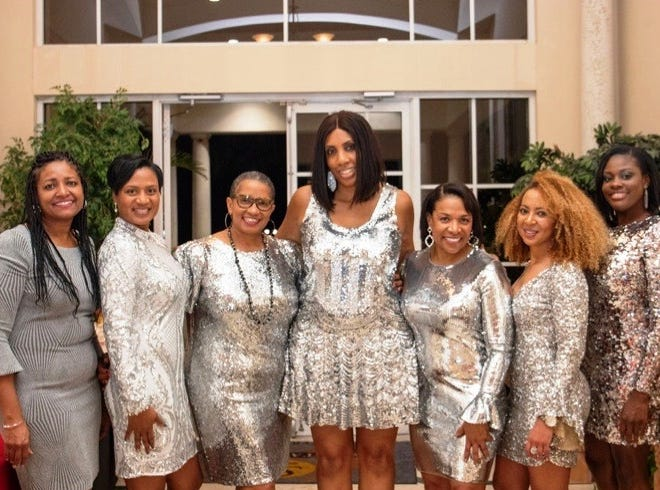 "Stephanie Taylor, left, Arnater Dowers, Arlene Shackelford, Tamara Williams, Phyllis Gillespie,  Natasha Harrison and Kherri Anderson at the ""Lucky In Love"" Valentine's Day gala."