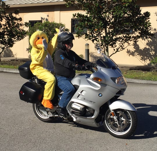 Quackers catches a ride with Michael Hyde at the Kruise for Kids Poker Run for Treasure Coast Community Health.