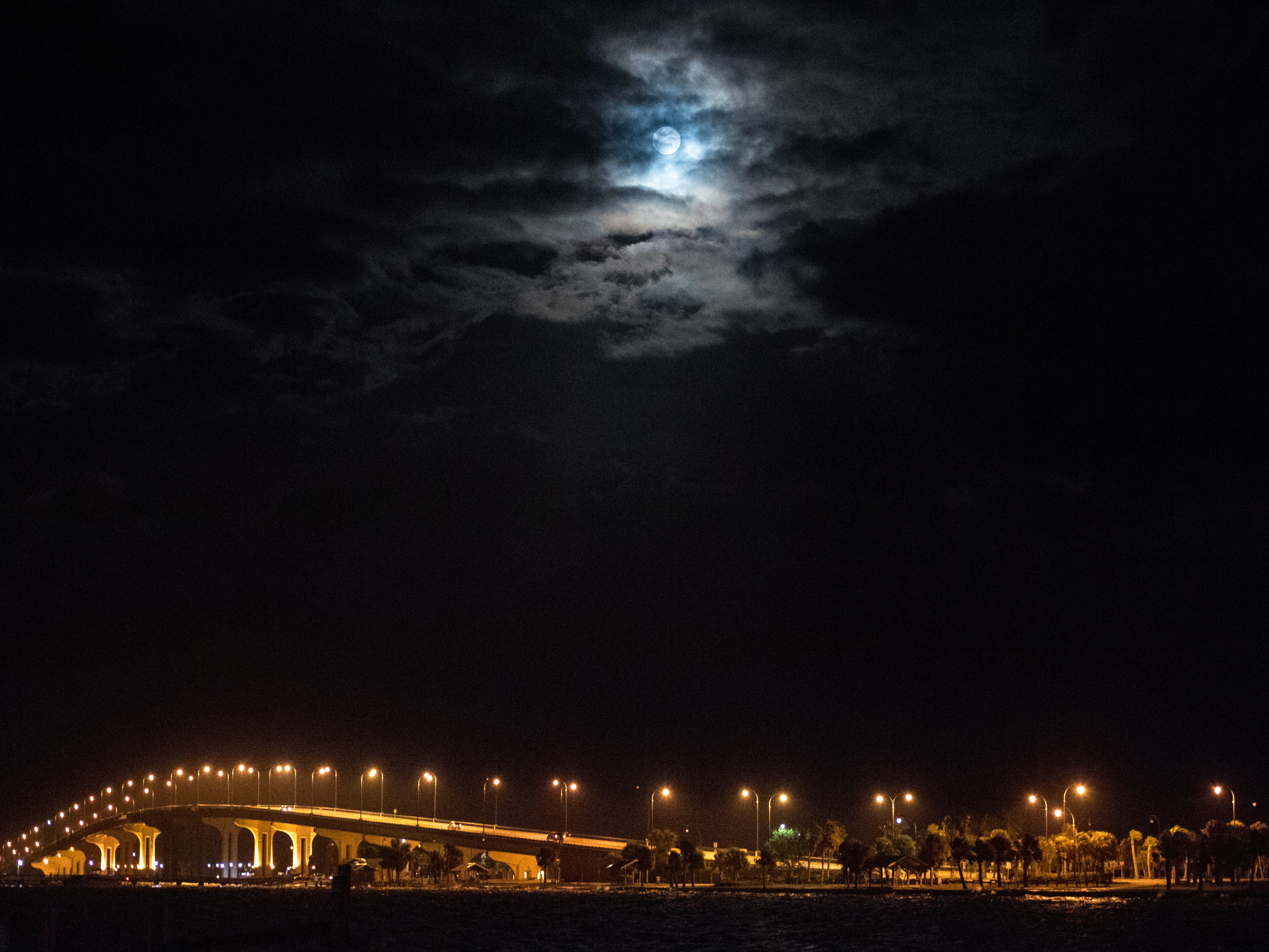 """The last supermoon of 2019, the """"super worm equinox moon,"""" hovers over the Jensen Beach Causeway on the vernal equinox Wednesday, March 20, 2019, as seen from Jensen Beach. The next supermoon will not occur until March 2020."""