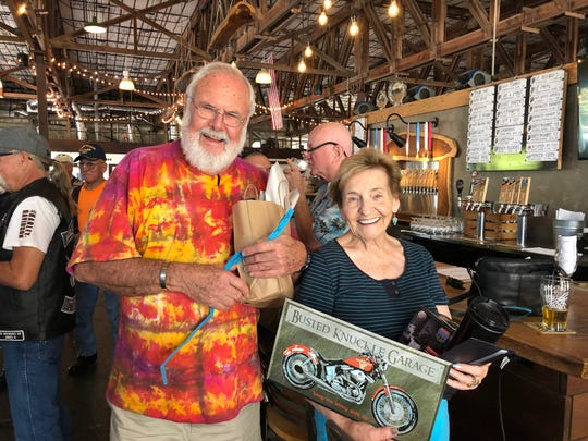 Raffle winners show off their prizes, which were donated  from Walking Tree Brewery, Everything Biker Consignment Shop and V-Twin Concepts.