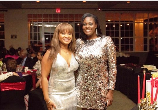 "Event Co-Chair Mia Pintard, left, and Kherri Anderson at the ""Lucky In Love"" Valentine's Day gala."