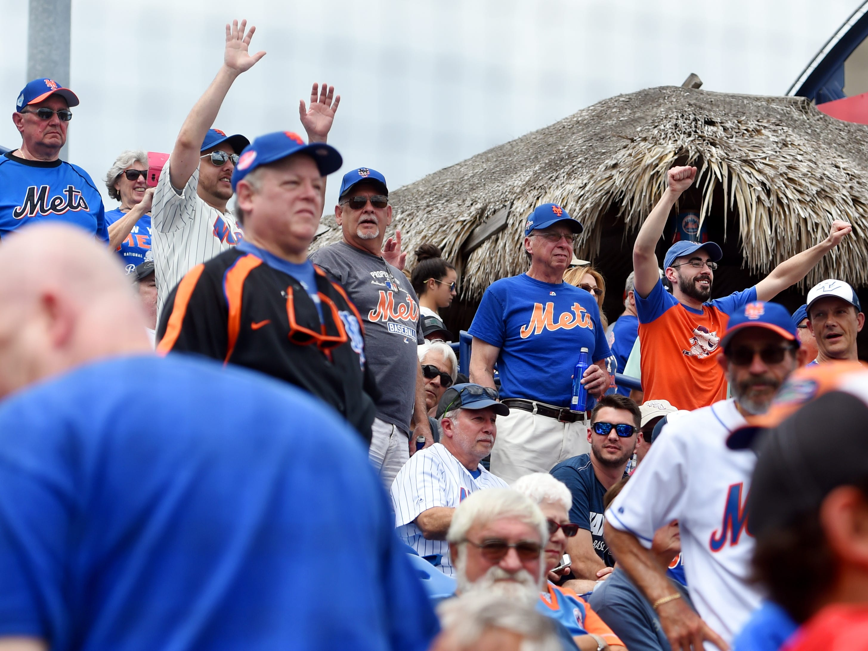Fans begin to cheer as the New York Mets take the field for a spring training game against the Miami Marlins on Thursday, March 21, 2019 at First Data Field in Port St. Lucie.