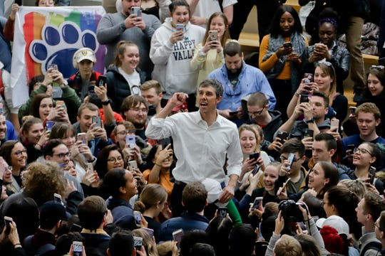 Democratic presidential candidate Beto O'Rourke stands on a chair in the midst of a crowd of students in The Hub Robison Center on the Penn State campus in State College, Pa., on Tuesday, March 19, 2019.