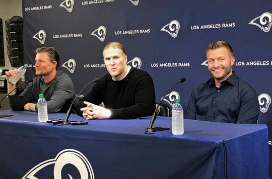 Agoura High graduate Clay Matthews, center, answers a question while head coach Sean McVay, right, and general manager Les Snead, left, look on during a news conference announcing the Rams signing of the former Packers linebacker on Thursday in Thousand Oaks. Matthews agreed to a two-year contract to return to his native Southern California after playing for a decade for Green Bay.