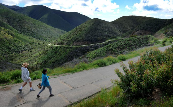 Bobby Chang, left, and Shirley Kao hike down to Point Mugu State Park Wednesday on a cloudy afternoon. A new report ranks Ventura County as the ninth healthiest county in California, partly because of its access to physical activity.
