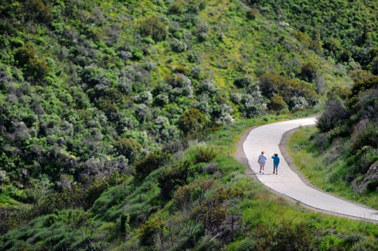 Bobby Chang, left, and Shirley Kao walk down to Point Mugu State Park on a cloudy Wednesday afternoon. A new report ranks Ventura County as the ninth healthiest county in California, partly because of its access to physical activity.