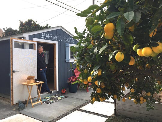 Desserts to Die For owner Deb Dawson pauses in the doorway of the backyard shed once used as an office by a former roommate. Dawson, whose kitchen is licensed as a cottage food operation, has turned the space into the location of her weekly pop-up known as Bakewell House.