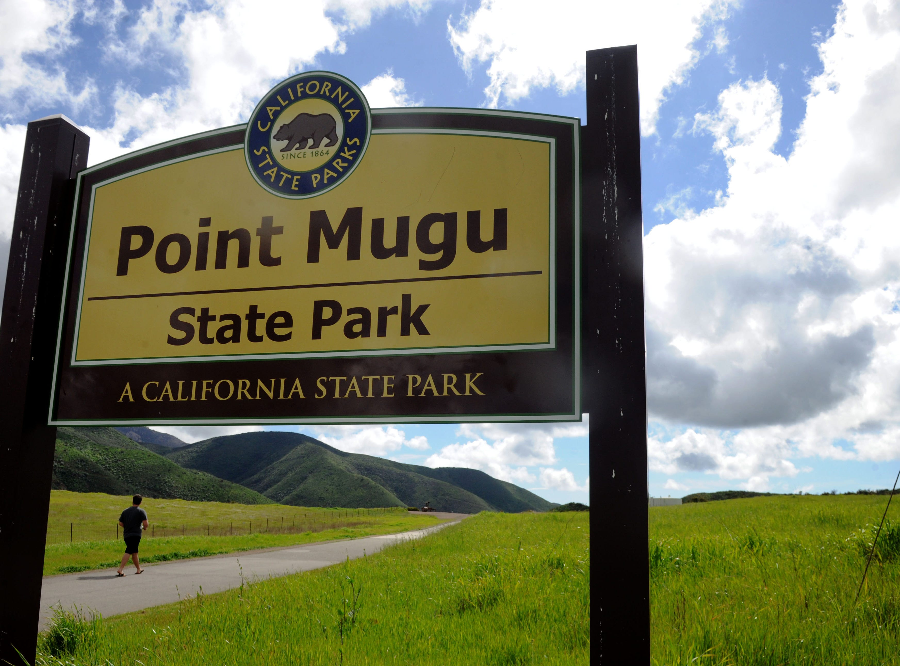 A hiker crosses over from Rancho Sierra Vista to Point Mugu State Park on a cloudy Wednesday afternoon. A new report ranks Ventura County as the ninth healthiest county in California, partly because of its access to physical activity.